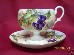 This cup and saucer set is entirely hand decorated, no signature and it is in excellent condition, no damage or wear. The cup is 3 1/4 H x 3 1/2 W. at the rim and the saucer is 5 3/4 W. I will list