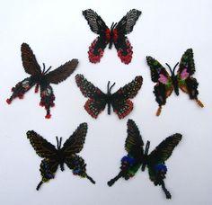 Six Black Butterflies