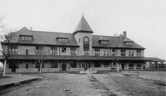 Missouri -Kansas-Texas Railroad depot, Parsons, Kansas  This black and white photograph shows the Missouri- Kansas-Texas Railroad depot at Parsons, Kansas. The depot had a large dining room, restaurant, and self-winding clock in the tower. The depot burned to the ground in March of 1912.  Date: Between 1895 and 1912