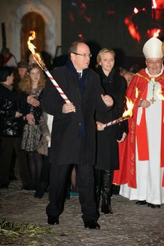 26 JANUARY 2014 Prince Albert and Princess Charlene attended the Sainte-Devote ceremony in Monaco.