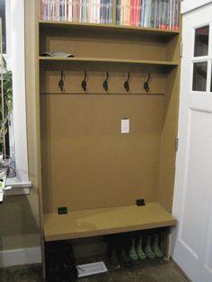 Image of the finished studio entrance bench and coat hooks.