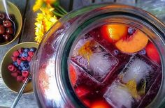 Fruity Sangria 8-10 servings  2 bottles dry red table wine 1 cup brandy 1/2 cup triple sec 2 cups orange juice 1/2 cup simple-syrup (optional) Peaches, sliced Oranges, halved or cut into rings A handful each of raspberries and blueberries Ice cubes