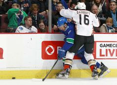 Ryan Garbutt #16 of the Anaheim Ducks checks Emerson Etem #26 of the Vancouver Canucks