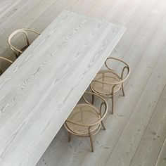 Wide plank flooring and bespoke table at Kvadrat Showroom, Stockholm - Douglas by Dinesen - stairs with Bright White should end up looking like this. From Oricalcum UK (dinesen and they get from Linolie DK)