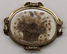 A broach with a flower design made of human hair. Worn while the person was in mourning. A memory to keep for ever.