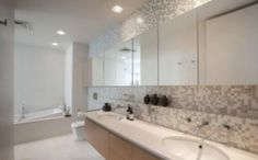 Like the floating vanity, mosaics and mirror cupboards for family bathroom or full mirror wall over vanity