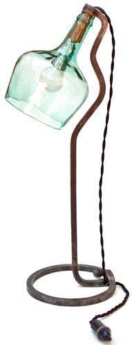 Wrought iron lamp and demijohn. by Metonimia