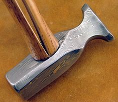 Damascus steel hammer. I can't even imagine how difficult this would be to forge. So many layers!