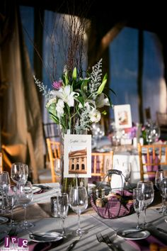 Lavender and lilies set the tone for the evening at Christine and Nate's Audubon wedding: JPG Photography.