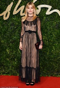 Chic: From the front Georgia's dress looked demure as she joined the star-studded line-up ...