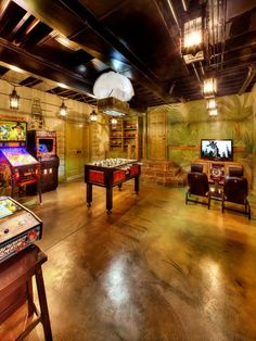 , Marvelous Tropical Basement Remodel Ideas For Games Area Also Comely Concrete Floor Design With Plants Wall Mural Picture Also Cool Ceilng Lamps Design And Various Game Arcade And Soccer Table: Beautiful Basement Remodeling Pictures and Ideas