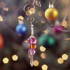 Beaded icicles made from beads and copper wire. Use for tree, party favor, gift decoration, or napkin ring embellishment.