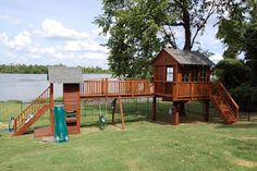 Treehouse with zip line, swings, slide, bridge, and attached playhouse  #treehouse #swingset #kids #backyard