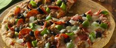 Bisquick® Gluten Free mix crust topped with sausages and veggies for a cheesy pizza – a perfect Italian dinner.