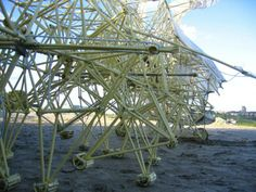 A close up of the legs of the Strandbeest as it walks on the sand (Photo: Theo Jansen)