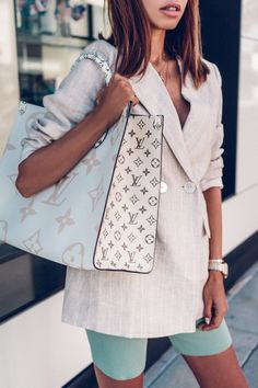 3 Pieces You Will Wear All Summer Long Obsessed with my new Louis Vuitton on the go tote! So roomy and stylish, it's going to be my go to handbag for the summer and definitely perfect for travel days. Wearing it with a linen blazer and biker shorts Vuitton Bag, Louis Vuitton Handbags, Purses And Handbags, Louis Vuitton Monogram, Luxury Handbags, Designer Handbags, Fabric Handbags, Replica Handbags, Cheap Handbags