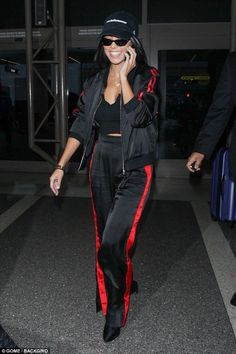 On the move... Kourtney Kardsahian was seen arriving at LAX airport on Friday night, as she prepared to catch a flight