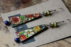 Because She Feels Like Cleopatra earrings- Floral, Recycled,Vintage, Tin Jewelry,Shoulderduster, Tribal, Flral Tin, Bohemian, Spring, Gipsy---Vintage floral tin from Holland, solid copper sheet as a second layer, lemon Jade embraced by decorative cap beads, some brass spacer, Lapis Lazuli. Dangle 4 9/16 inches long including stone and ear wires