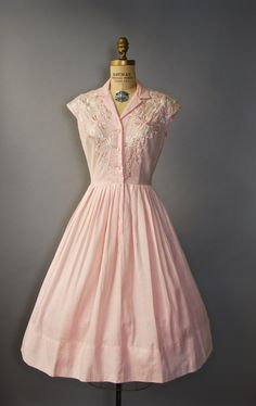 Stunning 1950s pale pink shirtdress with nipped waist, full skirt, short cap sleeves, buttons up the bodice, gorgeous floral embroidery along the