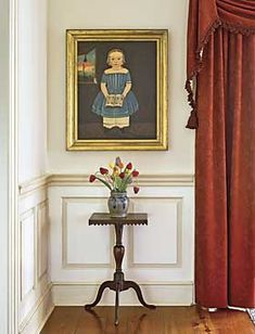The young girl, by Sturtevant Hamblin, circa 1840s, is identified as Sarah North of Portland, Maine. The glass tulips set into a cobalt decorated stoneware crock are one of several bouquets in the house. The New England square-top candlestand, with sawtooth applied edge, was found in Herkimer, New York, and dates to circa 1820. It was purchased from Sam Herrup.