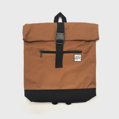 WAS: £25 - NOW: £20 Caramel / Black Rolltop Backpack with large front buckle. This Padded 15.7' compartment for Laptop's. Padded...