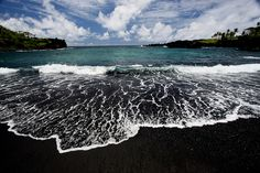 Black sand beach at Waianapanapa State Park, in Maui, Hawaii