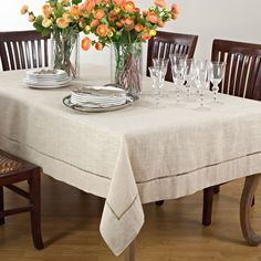 "Dress your table in comtemporary elegance with Saro Lifestyle's ""Toscana"" Collection classic hemstiched tablecloths. These oblong tablecloths are available in designer natural."
