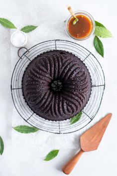 One Bowl Devil's food bundt cake with bay leaf caramel - a dense, moist chocolate bundt cake is loaded up with a lightly infused bay caramel. The cake is amazing alone, but with the caramel it is the perfect match. Cupcakes, Cupcake Cakes, Bundt Cakes, Baby Cakes, Cake Recipes, Dessert Recipes, American Desserts, Chocolate Bundt Cake, Devils Food