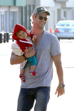 "Chris Hemsworth: All Smiles With Daughter. I love that her socks don't match. Think Dad dressed her? ""Close enough"""
