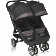 City mini double jogging stroller. (Fits through doorways and the seats fully recline.)