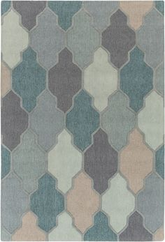 Embodying timeless traditions of construction while maintaining the fabulous and fashionable elements of trend worthy design, this flawless rug will effortlessly cement itself as the center point to your space. Hand Tufted in 100% wool, the dazzling...
