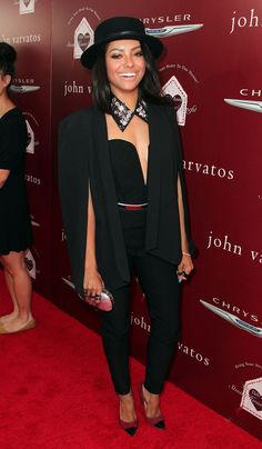 Edgy actress and singer Kat Graham rocked a cape blazer with a sexy strapless jumpsuit.