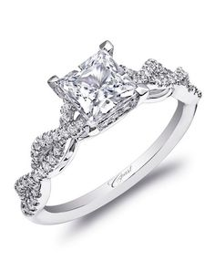 , this engagement ring features a double helix design on the band, leading the eye to a princess cut diamond.
