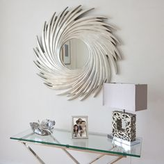 Adding a silver sunburst mirror to your living room makes the space look bigger, more interesting and more inviting. A mirror mounted over a large sofa in the living room gives an elegant look and feel to the room Silver Sunburst Mirror, Sun Mirror, Mirrors Silver, Silver Frames, Wall Mirrors, Modern Mirror Design, Modern Bedroom Design, Contemporary Mirrors, Modern Wooden Doors