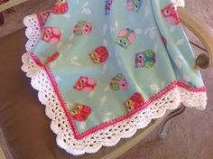 Soft Blue, Green, pink owl fleece baby blanket with a white and pink pretty crocheted edging. Blanket measures 31 x 43. This would be perfect for any baby girl. Blanket is machine washable and dryable