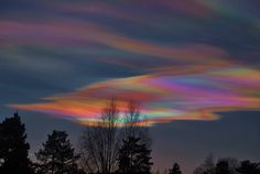"""This is called """"Perlemorskyer"""" in Norway or we would call it Polar Stratospheric Clouds or nacreous clouds. This photo was taken by Elin Fumuholt in Norway. They're rare because the stratosphere doesn't hold much moisture and they need to be lit from sunlight below meaning this happens around dawn or dusk. WILD! A detailed explanation of these clouds is found here: http://en.wikipedia.org/wiki/Polar_stratospheric_cloud"""
