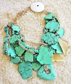 Necklace    Twiga Gallery Designs.  Turquoise, gold plated leaves, Naga Chank shell clasp with gold plated chain