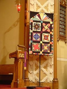 This banner was made by a very talented quilter in our congregation. It doesn't have any words, and it doesn't even have any Christian symbols on it. But I think it really looks beautiful in our sanctuary during the season. Christian Symbols, Church Banners, Fabric Art, Sewing Tutorials, Worship, Amen, Stained Glass, 3 D, Quilting