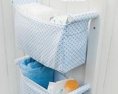 This gorgeous set of hanging nursery storage baskets is ideal to hang near the changing table or on a wall in the bathroom so that you have everything you need right at hand when your hands are full of a wet or wriggly baby!  You can use it as a diaper caddy to store diapers, wipes and other accessories or baby shampoo, q-tips, wash cloths and the like in the bathroom. As your child gets older it can transition to a hanging toy storage to keep things neat and tidy and up out of the way. Or…