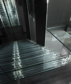 """SANTAMBROGIOMILANO is a business enterprise that develops projects from the glass as exclusive unique pieces that can fit in all areas of daily life. The collection called SIMPLICITY was born from the cooperation of Carlo Santambrogio and the designer Ennio Arosio. This innovative collection gives a """"transparent"""" shape to the a clean and essential way …"""