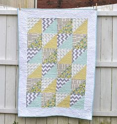 Quick Triangles Baby Quilt tutorial using 6 fat quarters, 5/8 for border, 1 1/2 for backing, and 3/8 for binding