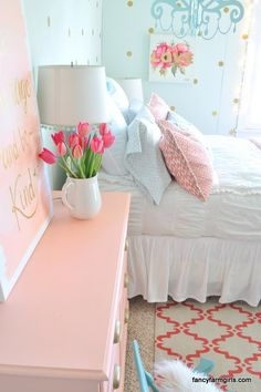 LOVE This girl's coral, mint and gold bedroom makeover