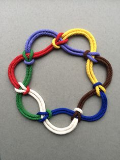 My first piece based on a mathematical knot with seven crossings. New colour of cord added is white.