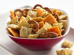 Cheesy Ranch Chex® Mix...9 c Corn Chex®, Rice Chex® or Wheat Chex® cereal (or combination), 2 c bite-size pretzel twists, 2 c bite-size cheese crackers, 3 tbs butter or margarine, 1 package (1oz) ranch dressing and seasoning mix, 1/2 c grated Parmesan cheese...