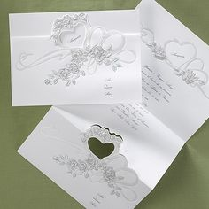 Rose Bouquet - Invitation...Elegance is depicted perfectly with the embossed roses on this distinctive invitation. The bright white Z-fold showcases the quinceañera's name within a pearl die-cut heart.
