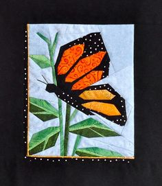 Paper pieced wall hanging for Spring or Summer. Monarch Quilt Pattern DW2-146 by The Designer's Workshop - Eileen Bahring Sullivan.  Check out our seasonal patterns. https://www.pinterest.com/quiltwomancom/seasonal-patterns/  Subscribe to our mailing list for updates on new patterns and sales! https://visitor.constantcontact.com/manage/optin?v=001nInsvTYVCuDEFMt6NnF5AZm5OdNtzij2ua4k-qgFIzX6B22GyGeBWSrTG2Of_W0RDlB-QaVpNqTrhbz9y39jbLrD2dlEPkoHf_P3E6E5nBNVQNAEUs-xVA%3D%3D