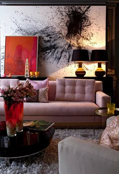 art ledge with layered pieces. that blush sofa is what makes the dramatic space liveable.