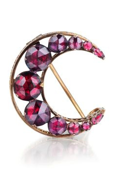 A beautiful antique rose cut garnet brooch in the shape of a crescent moon.