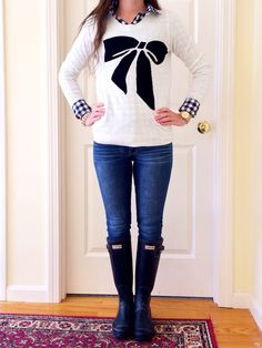 .cute sweater and hunter boots.