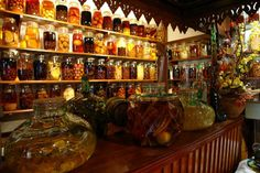 Rhum arrange with different fruits in the bottles